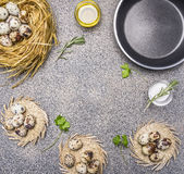 Ingredients for cooking fried quail eggs, oil and salt and herbs place for text,frame  granitic rustic background top view clos Stock Photo