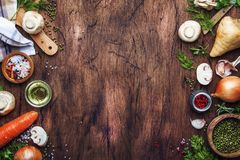 Ingredients for cooking green lentils with mushrooms and vegetables, spices and herbs, vintage wooden kitchen table background,. Place for text. Vegan or royalty free stock image