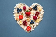 Ingredients for cooking healthy breakfast in shape of heart Royalty Free Stock Photography