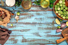 Ingredients for cooking healthy food on wooden table with border Royalty Free Stock Photo