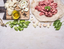 Ingredients for cooking homemade mincemeat on paper, parsley, garlic, onion bun and oils, border ,place text  on wooden rustic Royalty Free Stock Photo