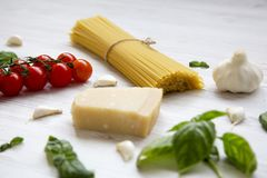 Ingredients for cooking italian pasta on a white wooden background,. Closeup Royalty Free Stock Photography