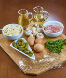 Ingredients for cooking jellied chicken with mushrooms pickled cucumber lettuce Stock Photography