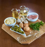 Ingredients for cooking jellied chicken with mushrooms pickled cucumber lettuce Stock Images