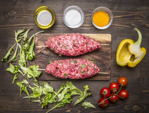 Ingredients for cooking  kebab vegetables  cutting board wooden rustic background top view close up Royalty Free Stock Photo