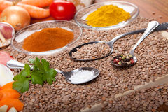 Ingredients for cooking lentil soup on wooden board, spice, vegetables, Royalty Free Stock Photo