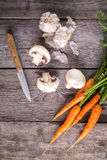 Ingredients for cooking: mushrooms, carrots and garlic Stock Photo
