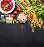 Ingredients for cooking pasta with shrimp, herbs, tomatoes, cheese, tomatoes in own juice border, place for text  on wooden rustic Royalty Free Stock Images