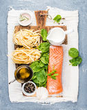 Ingredients for cooking pasta tagliatelle with salmon, spinach and cream Royalty Free Stock Photography