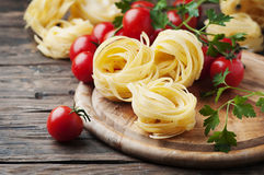 Ingredients for cooking pasta and tomato on the table Stock Photos