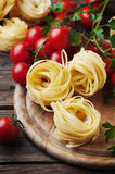 Ingredients for cooking pasta and tomato on the table Royalty Free Stock Image