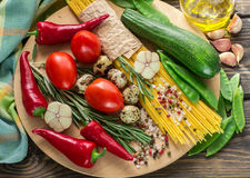 Ingredients for cooking pasta with vegetables Stock Photos