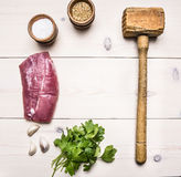 Ingredients for cooking  pork steak with herbs and spices lined frame place for text wooden rustic background top view Royalty Free Stock Photo