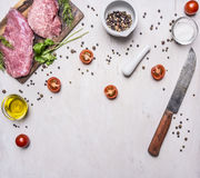 Ingredients for cooking Pork steak with vegetables and spices on wooden rustic background top view close up place text,frame Stock Photography