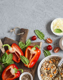 Ingredients for cooking quinoa stuffed bell peppers. Top view, flat lay. stock image