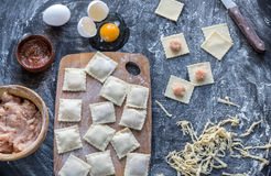 Ingredients for cooking ravioli on the wooden board. Top view Royalty Free Stock Images