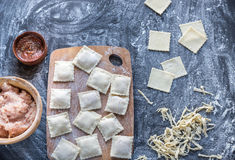 Ingredients for cooking ravioli on the wooden board. Top view Royalty Free Stock Photo