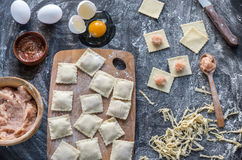Ingredients for cooking ravioli on the wooden board. Top view Stock Photo