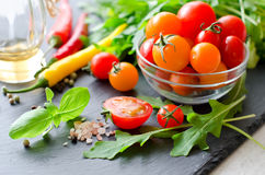 Ingredients for cooking salad with cherry tomatoes, herbs, chili Stock Images