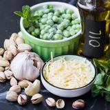 Ingredients for cooking sauce pesto with green peas, mint, chees Royalty Free Stock Photos