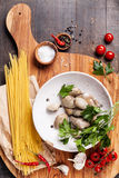 Ingredients for cooking spaghetti vongole Royalty Free Stock Photo
