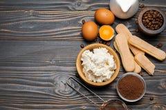 Ingredients for cooking tiramisu - Savoiardi biscuit cookies, mascarpone, cheese, sugar, cocoa, coffee and egg stock photos