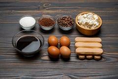 Ingredients for cooking tiramisu - Savoiardi biscuit cookies, mascarpone, cheese, sugar, cocoa, coffee and egg stock image
