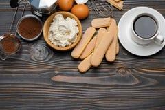Ingredients for cooking tiramisu - Savoiardi biscuit cookies, mascarpone, cream, sugar, cocoa, coffee and egg royalty free stock photo