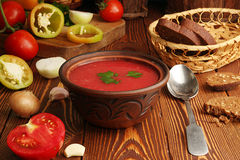Ingredients for cooking of tomato soup. Gazpacho. Ingredients for cooking of andaluz tomato soup. Bowl of gazpacho on wooden table Stock Images
