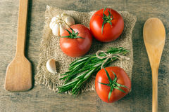 Ingredients for cooking. Tomatoes, greens, garlic. Royalty Free Stock Images
