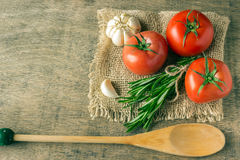 Ingredients for cooking. Tomatoes, greens, garlic. Stock Image