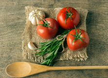 Ingredients for cooking. Tomatoes, greens, garlic. Stock Photo