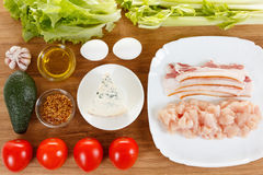 Ingredients for cooking traditional American Cobb Salad. Colorful entree salad with bacon, chicken, eggs and tomatoes a main-dish American salad royalty free stock photos