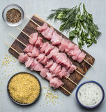Ingredients for cooking a turkey bulgur herb seasoning garlic sauce on a cutting board on a blue wooden background top view Stock Images