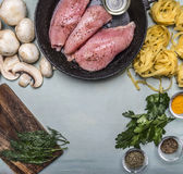 Ingredients for cooking a turkey mushrooms herb seasoning paste on an old frying pan  rustic wooden background top view Royalty Free Stock Photography