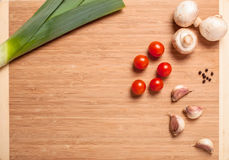 Ingredients for cooking with vegetables. Like a frame on a chopping board with free space for text stock photography