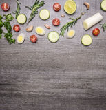 Ingredients for cooking vegetarian food cherry tomatoes, tomatoes, rosemary, onion, lettuce, parsley, cucumber, tiled frame woo Royalty Free Stock Image