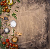 Ingredients for cooking vegetarian food cherry tomatoes, wild rice, spices, salt border ,place text  on wooden rustic backgrou Stock Photos