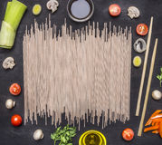 Ingredients for cooking vegetarian  Korean food,  onions, lettuce, cherry tomatoes, mushrooms, chopsticks place text, frame on Royalty Free Stock Images