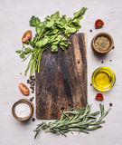 Ingredients for cooking vegetarian lunch, cherry tomatoes, parsley and rosemary, oil, pepper and salt place text,frame Royalty Free Stock Photography