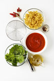 Ingredients for Cooking Vegetarian Pasta: tomato sauce, spinach, Royalty Free Stock Image