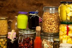 Ingredients for cooking on a wooden table. Glass of cooked vegetables and jam. Chef`s workplace. Ingredients for cooking on a wooden table. Glass of cooked Stock Photo