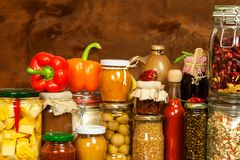 Ingredients for cooking on a wooden table. Glass of cooked vegetables and jam. Chef`s workplace. Ingredients for cooking on a wooden table. Glass of cooked Stock Photos