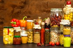Ingredients for cooking on a wooden table. Glass of cooked vegetables and jam. Chef`s workplace. Ingredients for cooking on a wooden table. Glass of cooked Royalty Free Stock Images