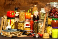 Ingredients for cooking on a wooden table. Glass of cooked vegetables and jam. Chef`s workplace. Ingredients for cooking on a wooden table. Glass of cooked Royalty Free Stock Photos