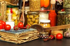 Ingredients for cooking on a wooden table. Glass of cooked vegetables and jam. Chef`s workplace. Ingredients for cooking on a wooden table. Glass of cooked Royalty Free Stock Image