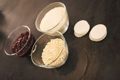 Ingredients for cranberry macaroons in small bowls stock image