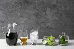Ingredients for Cuba Libre cocktail. On table Stock Image
