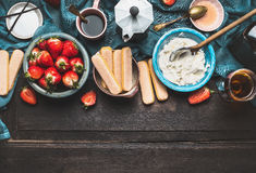 Ingredients for dessert making. Tiramisu preparation on dark rustic background, top view Royalty Free Stock Photo