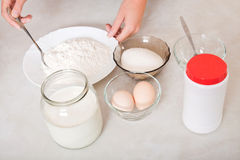 Ingredients for dough. And female hand Stock Photos